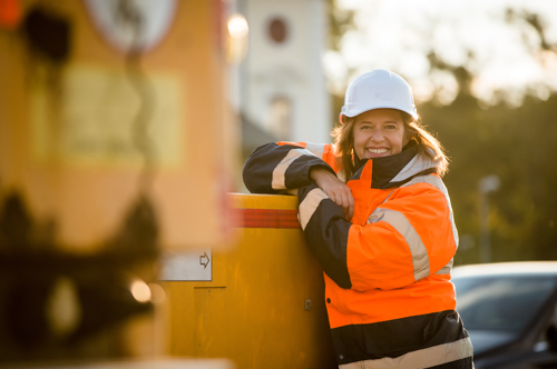 Smiling woman wearing high visibility clothing